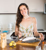 Housewife cooking fish Stock Photos