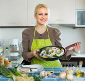 Housewife cooking fish at home Royalty Free Stock Photo