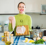 Housewife cooking fish soup Royalty Free Stock Images