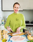 Housewife cooking fish soup Royalty Free Stock Photo