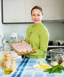 Housewife cooking fish soup Stock Image