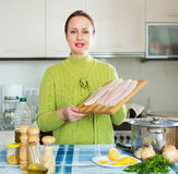 Housewife cooking fish soup Royalty Free Stock Image