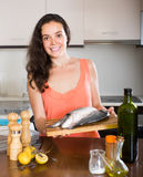 Housewife cooking fish Stock Photo