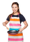 Housewife cooking with fried pan and wooden ladle Stock Image