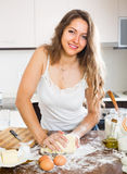 Housewife cooking at home kitchen Royalty Free Stock Image