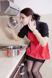 Housewife cooking in the kitchen Royalty Free Stock Images