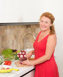 Housewife cooking in the kitchen Royalty Free Stock Image