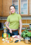 Housewife cooking at kitchen Royalty Free Stock Image