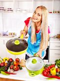 Housewife cooking at kitchen. Stock Photos