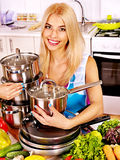 Housewife cooking at kitchen. Royalty Free Stock Image
