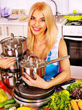 Housewife cooking at kitchen. Royalty Free Stock Photo