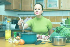 Housewife cooking at kitchen Royalty Free Stock Images