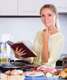 Housewife cooking with meat Royalty Free Stock Image