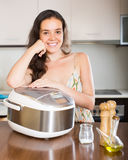 Housewife cooking with multi cooker Royalty Free Stock Photo