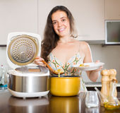 Housewife cooking with multi cooker Stock Photo