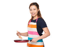 Housewife cooking with pan Royalty Free Stock Photography