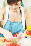 Housewife cooking salad Royalty Free Stock Photography