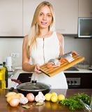 Housewife cooking from salmon Stock Photos