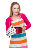 Housewife cooking with saucepan oven gloves Royalty Free Stock Image