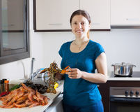 Housewife cooking sea food specialties Stock Photography