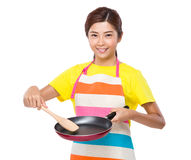 Housewife cooking something Royalty Free Stock Images