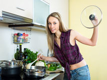 Housewife cooking soup Royalty Free Stock Image