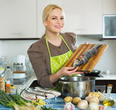 Housewife cooking soup with fish Royalty Free Stock Photo