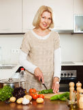 Housewife cooking vegetables Stock Photos