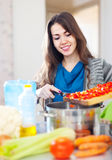 Housewife cooking veggie lunch Royalty Free Stock Photos