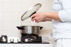 Housewife cooks dinner. In kitchen at home stock photo
