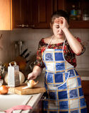 Housewife crying while cutting onion Royalty Free Stock Images