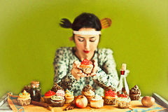 Housewife and cupcakes Stock Photography