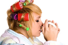 Housewife with curlers and cup Stock Images