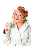 Housewife with curlers and cup Royalty Free Stock Photography
