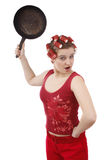Housewife with curlers, holding a frying pan. Royalty Free Stock Images