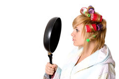 Housewife with curlers and pan Stock Photography
