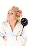 Housewife with curlers and skimmer Stock Photo