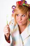 Housewife with curlers and toothbrush Royalty Free Stock Photography
