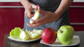 Housewife cut apples. stock video