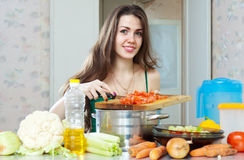 Housewife cuts vegetables Royalty Free Stock Photo