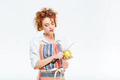Housewife cutting apple Royalty Free Stock Images