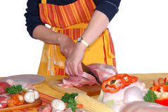 Housewife cutting meat Royalty Free Stock Images
