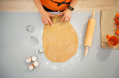 Housewife cutting out biscuits for Halloween party. Closeup Stock Images