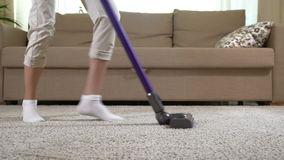 Housewife dancing with a vacuum cleaner. Dolly shot. stock footage