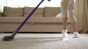 Housewife dancing with a vacuum cleaner. Slow motion. Dolly shot. stock footage
