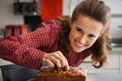 Housewife decorating freshly baked pumpkin bread Royalty Free Stock Images