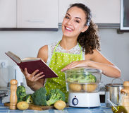 Housewife on diet cooking vegetables Stock Photo