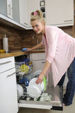 Housewife at the dishwasher Royalty Free Stock Images