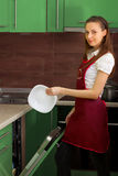 Housewife with the dishwasher Royalty Free Stock Images