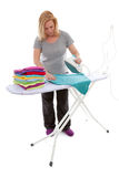 Housewife is doing the ironing Royalty Free Stock Photo